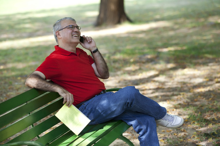 Senior man talking on a mobile phone