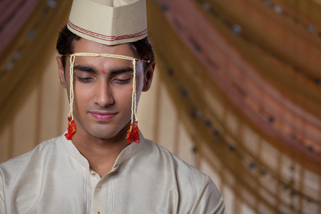 Close-up of Maharashtrian groom looking down LANG_EVOIMAGES