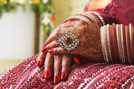 Close-up of a Brides hands in wedding bangles and ring