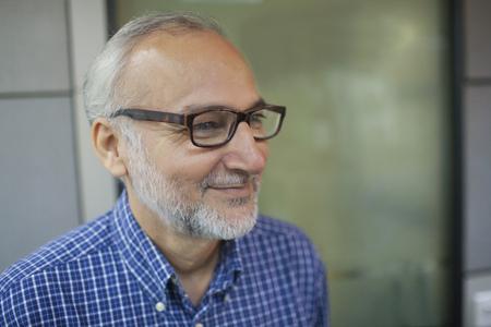 Side profile of senior business executive