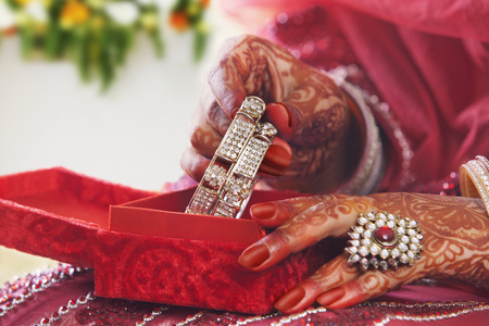 Close-up of a Brides hands placing bangles in bangle box