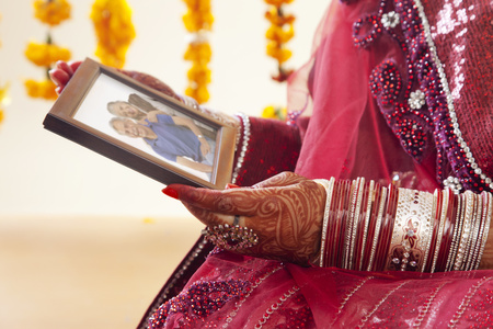 Close-up of a Brides hands holding picture frame
