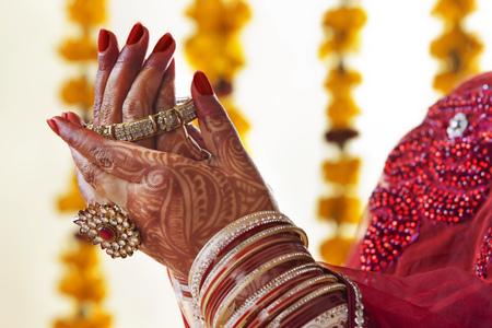 Bride wearing wedding bangles