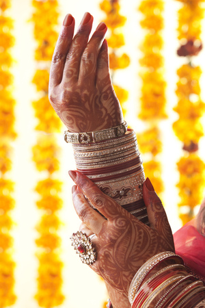 Brides hands in wedding bangles and ring