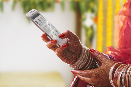 Close-up of a Brides hands using mobile phone