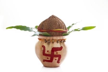 Close-up of a kalash with coconut
