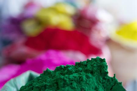 Holi festival color powder piles LANG_EVOIMAGES
