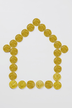 House of coins on white background