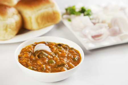 Pav bhaji with bread, onion and butter, indian food