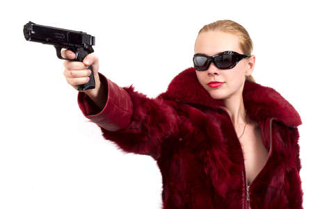 The blonde with a pistol in a hand photo