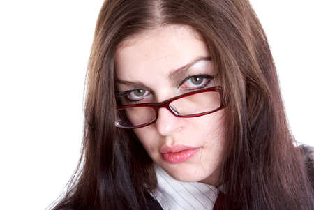 exacting: The girl looks atop of glasses Stock Photo
