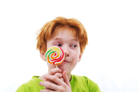 The red positive teenager with a sugar candy