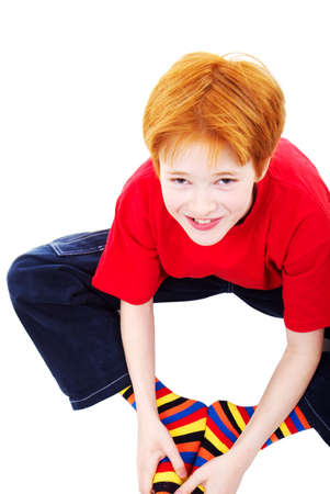 The positive red-haired teenager in striped socks photo