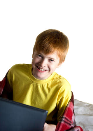 A smiling teenager with a laptop photo