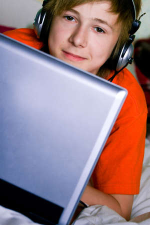 A smiling teenager with a laptop Stock Photo