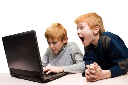 express positivity: Two boys use notebook, white background