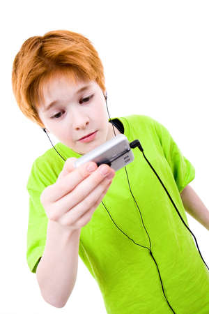 interrogatory: Red teen listens to music. The white background isolated Stock Photo