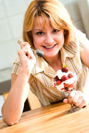 homemaker: Young beautiful girl with strawberries
