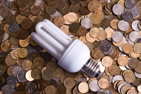 The lamp and is a lot of coins Stock Photo - 6303260