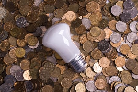 The bulb and is a lot of coins Stock Photo - 6303261