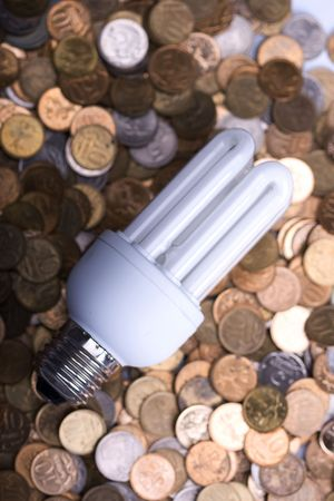 The lamp and is a lot of coins Stock Photo - 6303256