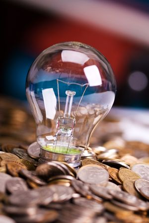 The bulb and is a lot of coins Stock Photo - 6303255