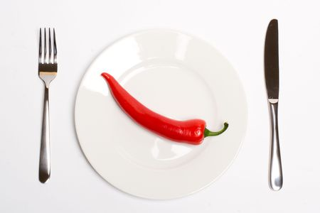 Red hot chili pepper on a plate Stock Photo - 6669524