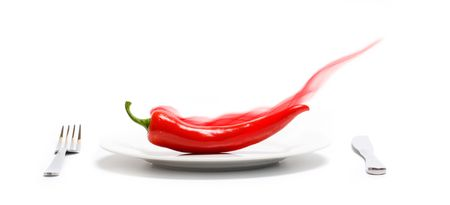 Smoking red hot chili pepper on a plate