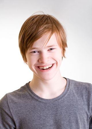 Red-haired teen happily laughing Standard-Bild