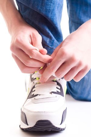 A teenager in jeans cords white sneakers. Close-up