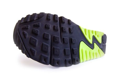 Running Shoe with green and black tread pattern on white
