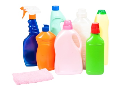 There are plastic bottles of various cleaning supplies. Isolated Standard-Bild