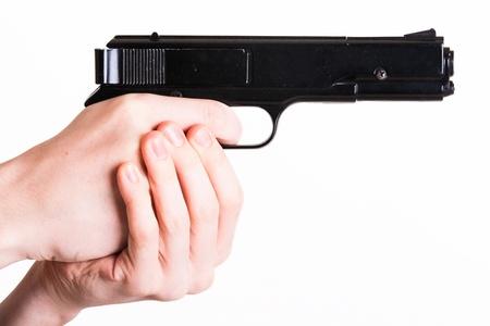 hand gun: Teen holds a handgun on white background