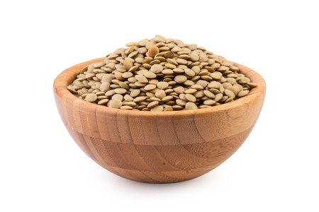Beans in wooden bowl on white background  Standard-Bild