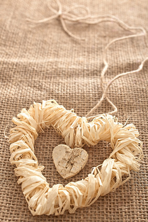 Valentines Day. Handmade Hearts made of bark and straw. Love concept. photo