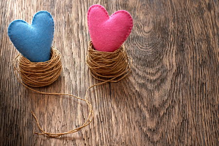 Valentines Day. Handmade Hearts Couple in nest. Love concept on wooden background Stock Photo