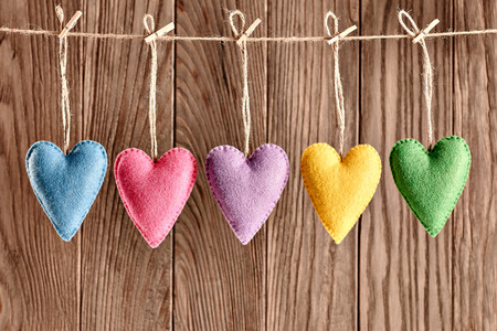 Valentines Day. Hearts Handmade set, hanging on rope. Love concept on wooden background photo