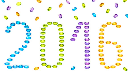 placer: New Year 2016. Christmas. Jewelry digits, colorful precious stones placer closeup isolated. Gems Topaz, Amethyst, Citrine, Peridot, vivid multicolored unusual greeting card. Sparkling happy holiday