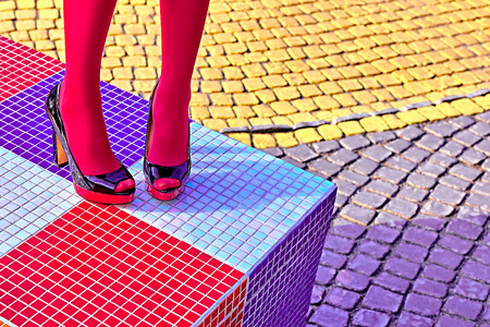 Fashion urban womens sexy legs, pantyhose, stylish heels.Vivid shiny multicolored geometry square pattern.Unusual, surrealism abstraction style. Girl in trendy shoes, creative mosaic.Outdoor, copyspace