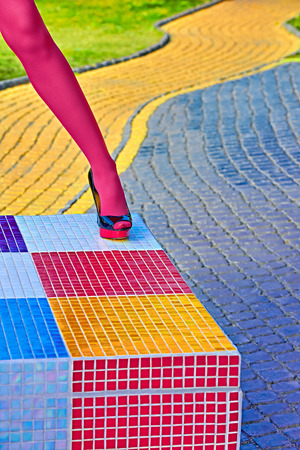 Fashion urban womens sexy legs, pantyhose, stylish heels, people. Vivid shiny multicolored geometry square pattern. Unusual, surrealism abstraction. Girl in trendy shoes, creative mosaic, outdoor