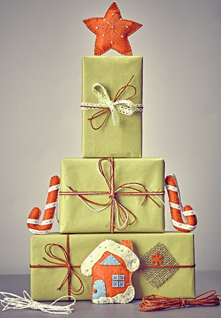 handmade: Gift boxes like fir tree. Christmas, candy cane house and star. Kraft paper bows ribbons lace. Festive creative New Year. Retro, vintage, greeting card, party decoration handmade, closeup