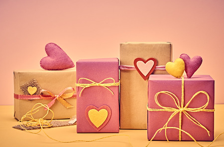 copyspase: Love hearts, Valentines Day. Handcraft gift boxes, presents stack. Couple of hearts. Retro romantic styled. Vintage retro concept, unusual greeting card.  , multicolored felt, copyspase Stock Photo