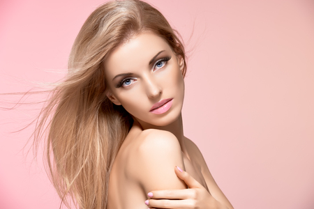 nude girl: Beauty portrait nude woman, long eyelashes, perfect skin, natural makeup, fashion. Sensual attractive pretty blonde sexy model girl on pink, shiny straight hair. People face closeup, spa, copyspace