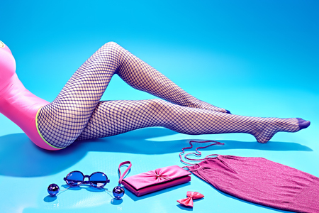 fishnet tights: Fashion clothes stylish set, accessories and womans sexy legs in tights , people. Glamor girl, creative look with trendy pink top, clutch, necklaces, sunglasses. Unusual luxury elegant party style