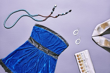 velours: Fashion clothes stylish set, blue mini dress and accessories. Glamor creative, trendy shiny silver clutch, necklaces, earrings, luxury shoes heels. Unusual elegant evening party style, copyspace Stock Photo