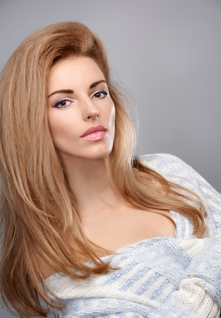 pink lips: Beauty fashion portrait woman in stylish warm knitted sweater. Sensual attractive pretty blonde sexy model girl, shiny straight hair, confidence. Unusual creative provocative. Emotional playful people Stock Photo