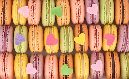 Macarons sweet traditional french colorful. A lot of fresh  pastel delicious dessert in box with multicolored hearts. Retro vintage background. Love, Valentines Day