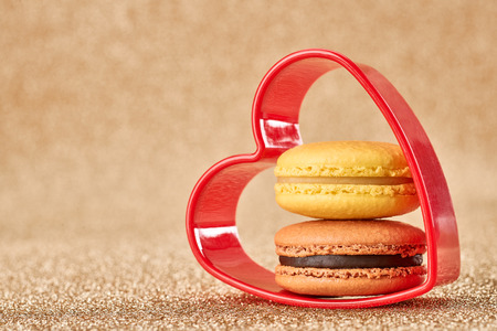 sweet heart: Valentines Day. Love. Red heart, Macaron french sweet delicious dessert yellow, chocolate. Vintage retro romantic style. Unusual creative art greeting card, gold background, copyspace