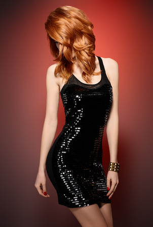 provocative woman: Fashion portrait of sexy beauty woman in stylish sequins dress. Unusual creative provocative. Emotional playful redhead glamour girl, luxury accessories, evening elegant party style on red, people