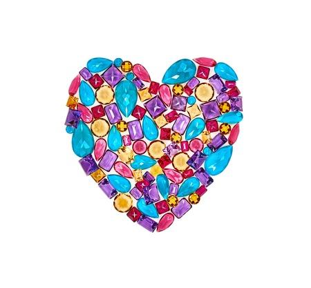 placer: Fashion lot of gemstone heart shape. Luxury shiny glamor colorful placer. Awesome precious stones mosaic, multicolored creative unusual decoration. Love concept.Celebration holiday background isolated Stock Photo